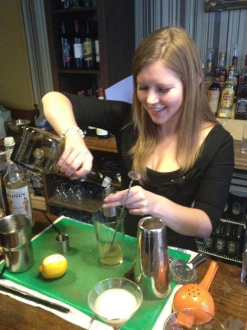 Jade mixing a Martini